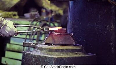 farrier is forging a horseshoe