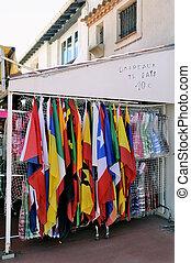 Shop at Saintes-Maries-de-la-Mer that sells flags of all...