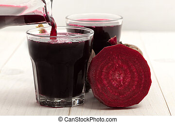 Beetroot juice - Beetroot with beet juice on white wood