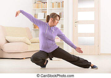 Woman doing qi gong tai chi exercise - Beautiful woman doing...