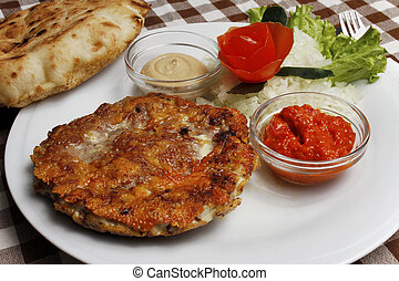 Traditional Balkan pljeskavica with - Image of Traditional...