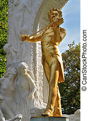 The statue of Johann Strauss - Park in Vienna Elegant gilded...