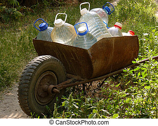 carriage of water bottles - wheelbarrow full of plastic...