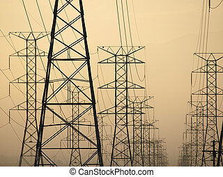 Triple Tower Sunrise - Three power towers at sunrise in...