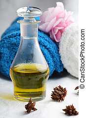 Massage oil and towels. - A close-up of a glass bottle...