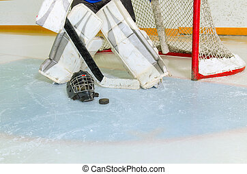 Hockey Goalie in Crease Getting Ready - A Hockey Goalie in...