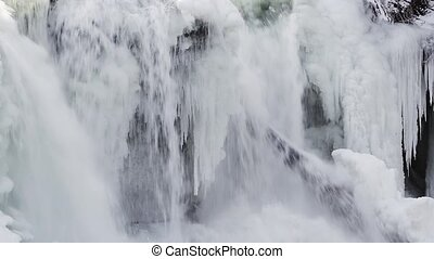 Winter Waterfall Loop - Water pours over the edge and past...