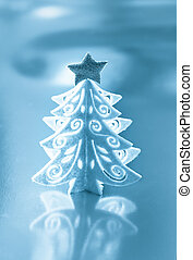 Decorative white Christmas tree with a silver star