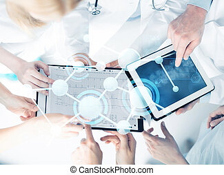 group of doctors with tablet pc and clipboard - healthcare,...