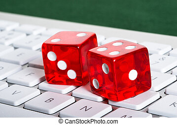 Online gambling concept - Dices on computer keyboard in...