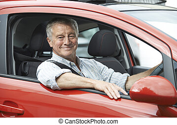 Portrait Of Senior Man Driving Car