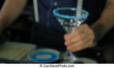 Bartender puts empty glass on bar - The bartender puts on...