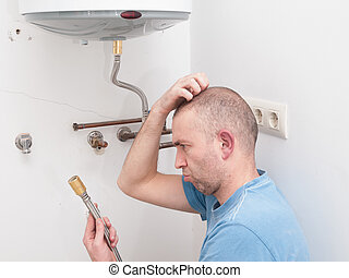 Inexperienced plumber trying to repair an electric water...