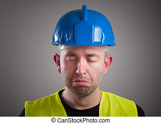 Portrait of a worker expressing negativity and sad, isolated...