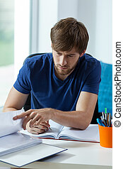 Student during work - Attractive student during his work for...