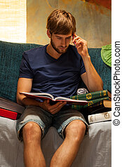 Studying hard - Young man studying hard in his room
