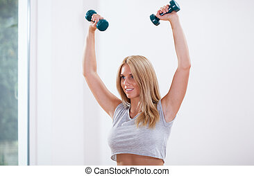 Woman training arm muscles