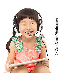 closeup of little student girl holding a tablet