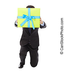 Businessman holding a gift box and kneel down . isolated on...