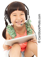 closeup of happy little student girl holding a tablet