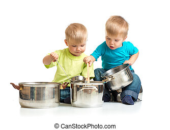 children playing with pans as they are cooking together...