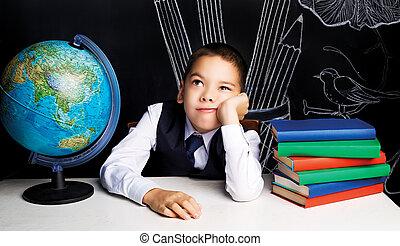 bored schoolboy - seven year old school boy sitting by the...