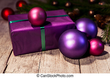 purple christmas gift on a wooden table