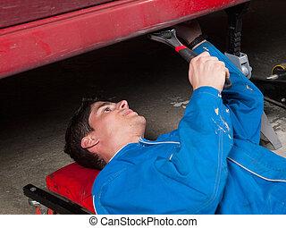 Mechanic repairing a a car