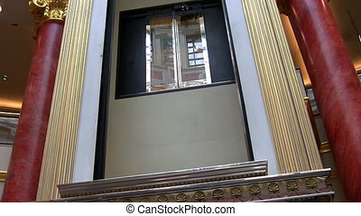 Transparent glass elevator going up - Luxury indoor empty...