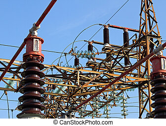 insulators and electric cables in a large power plant -...