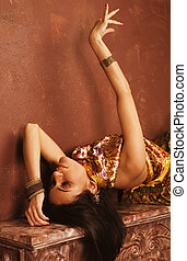 beauty sensual young woman in oriental style, luxury room -...
