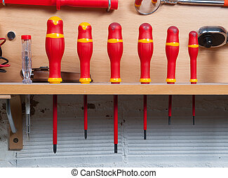 screwdrivers in row in a garage