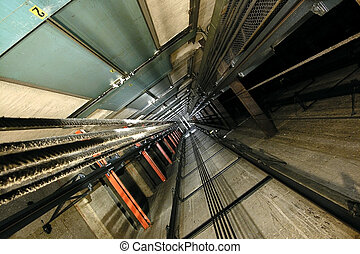 Elevator Shaft - The view up inside a tall elevator shaft.