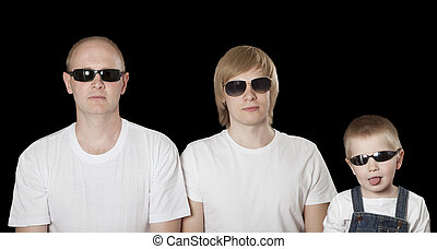 Three blonde males in sunglasses over black - Portrait of...