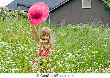 Happy Go Lucky - Little girl in a field of daisies