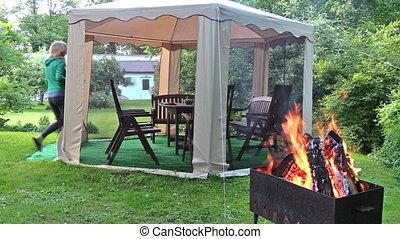 woman prepare supper - Woman prepare supper table in outdoor...
