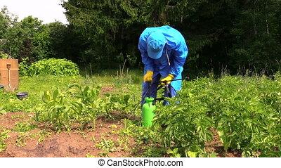 farmer prepare pesticide - Farmer man in waterproof clothes...