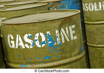 gasoline drums - store of well used gasoline fuel drums