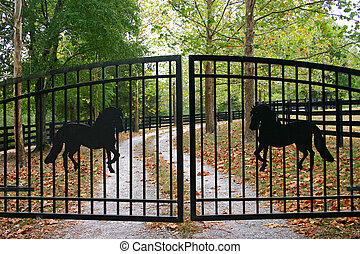 No Entry - an iron gate with silhouettes of horses closing...