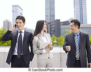 asian business team - business people having a good time