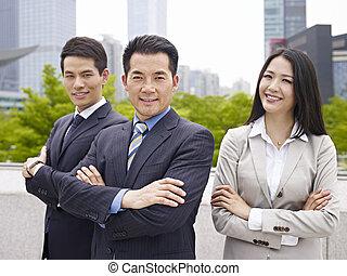 asian business team - outdoor portrait of an asian business...