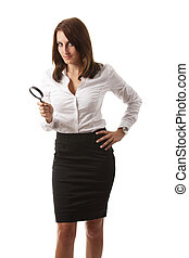 business woman with a magnifier