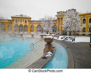 Szechenyi thermal bath in Budapest at snowy winter day,...