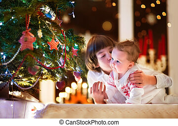 Children at Christmas tree - Brother and his baby sister...