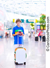 Boy traveling by airplane - Happy excited teenager boy...