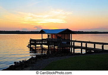 Fishing Boat Dock at Sunset on the St Johns River in Florida...