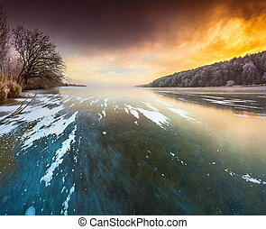 Sunset on the frozen lake