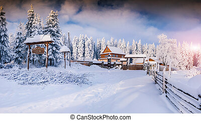 Sunny winter landscape in the mountain village