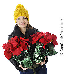 Teen Bringing Christmas Poinsettias - A pretty teen girl...