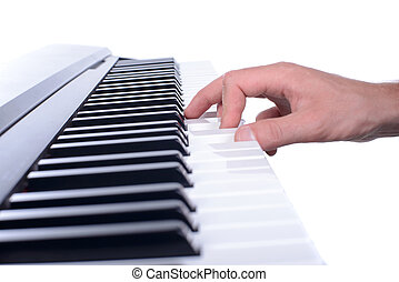 Music - Male hands playing digital piano Isolated over white...